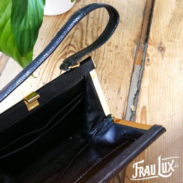 Frau Lux Vintage – schwarze Lederhandtasche mit Goldverschluss
